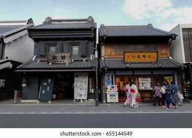 Kawagoe, Japan - April 13, 2017: Many tourists and local people are walking along traditional shops and stores in Kawagoe. Kawagoe town originating from Japan's Edo Period.