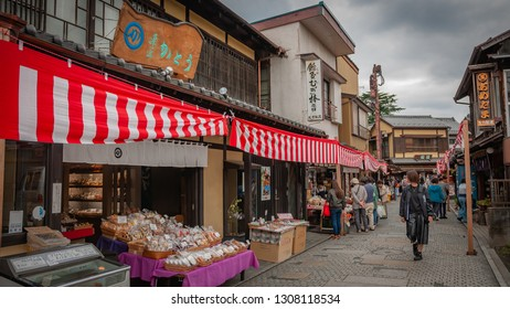 KAWAGOE, JAPAN - OCTOBER 11, 2016: Old clay warehouses and merchant homes which resembles the ones from the Edo-period, with tourists walking around in what is now a famous sightseeing spot.
