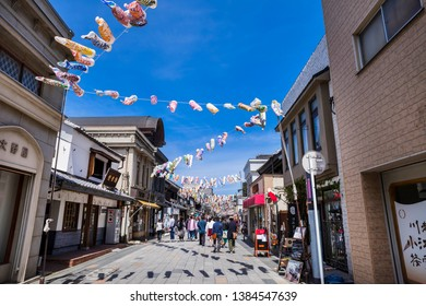 KAWAGOE, SAITAMA / JAPAN - APRIL 28 2019 : Landscape of the old shopping street in Kawagoe city. A streamer in the shape of a carp is swimming in the sky. It can be seen from late April to early May.