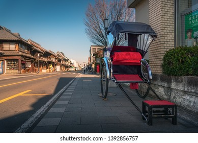 "KAWAGOE, SAITAMA / JAPAN - JANUARY 23 2019 : Old cityscape of Kawagoe city, Saitama prefecture. Scenery of a small street with a bell tower called ""Time's bell""."