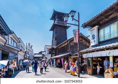 "KAWAGOE, SAITAMA / JAPAN - JUNE 16 2017 : Old cityscape of Kawagoe city, Saitama prefecture. Scenery of a small street with a bell tower called ""Time's bell""."