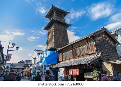 KAWAGOE,SAITAMA PREFECTURE,JAPAN - FEBRUARY 3 ,2016 : Cityscape of ancient little Edo with ancient Bell Tower at Kawagoe old town and tourists walking on street,This is a famous place in Japan.