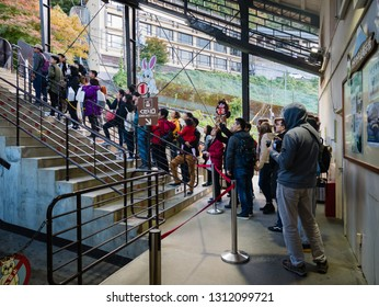Kawaguchi, Japan - November 1, 2018: Tourists are waiting for cable car at Kachi Kachi ropeway near lake Kawaguchi, Japan