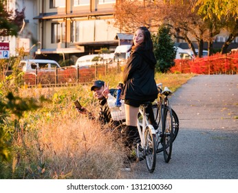 Kawaguchi, Japan - November 1, 2018: Tourist with bicycle near lake Kawaguchi, Japan for sightseeing.