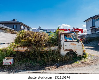 Kawaguchi, Japan - November 1, 2018: Old trucks near Kawagichiko lake, Yamanashi, Japan. Lake Kawaguchi is part of Fuji Five Lakes in Fuji-Hakone-Izu National Park