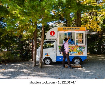 Kawaguchi, Japan - November 1, 2018: Tourist information bus parking near to Chureito Pagoda in Fujiyoshida, Yamanashi Prefecture.