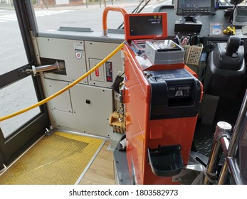 KAWAGUCHIKO, JAPAN - April 12, 2019: Automatic fare bus payment machine in the city bus. Public transportation, Fare collection system, Daily life, Smart card of Japan.