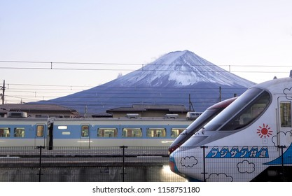 KAWAGUCHIKO, JAPAN - NOVEMBER 19, 2017: A local Japanese train at Kawaguchiko station with Mount Fuji in background.