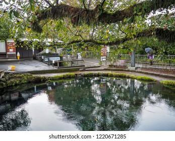 Kawaguchiko, Japan - October 19, 2018: Traveller visits Oshino Hakkai. Oshino Hakkai, is a small village in the Fuji Five Lake. It consists of 8 ponds.