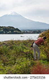 Kawaguchiko, Japan - September 27, 2014: People take a photo mountain Fuji from kawakuchiko lake, Japan.