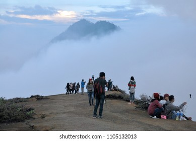 Kawah Ijen mountain Indonesia - May 3 2017 : Many tourist on the edge Volcanic crater of Kawah ijen volcanos is composite volcanoes and Sulfur mining in the Banyuwangi Regency of East Java Indonesia.