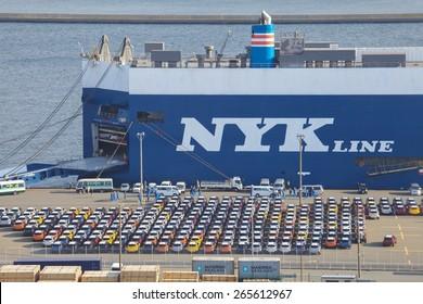 Kawasaki - FEB 27 , 2015 : New Japanese car waitng for import at Kawasaki sea port , Kawasaki city , Japan