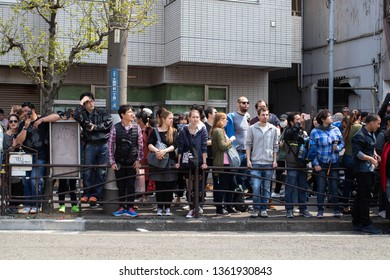 Kawasaki, Japan - April 7, 2019: The Shinto Kanamara Matsuri (Festival of the Steel Phallus) in Kanayama Shrine, a lot of tourist waiting for parade near the street