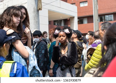 Kawasaki, Japan - April 7, 2019: The Shinto Kanamara Matsuri (Festival of the Steel Phallus) in Kanayama Shrine, beautifull African American girl inn crowd
