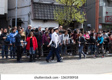 Kawasaki, Japan - April 7, 2019: The Shinto Kanamara Matsuri (Festival of the Steel Phallus) in Kanayama Shrine,  policeman speeds up the crowd