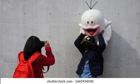 Kawasaki, Japan - Feb 28, 2018: Visitors are taking pictures with Obake no Q-Taro Character. Obake no Q-Taro Character Installation in Fujiko F Fujio Museum or Doraemon Museum.