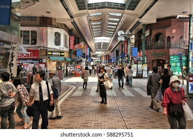 KAWASAKI, JAPAN - MAY 10, 2012: People shop at covered city shopping streets of Kawasaki, Japan. Kawasaki city is inhabited by 1.44 million people.