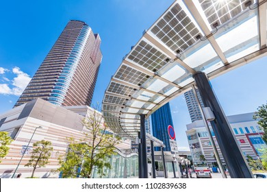 """KAWASAKI, KANAGAWA / JAPAN - APRIL 23 2017 : Scenery in front of """"Musashi-kosugi"""" station. In front of the station is a modern urban landscape with commercial buildings and high-rise residences."""