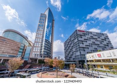 "KAWASAKI, KANAGAWA / JAPAN - OCTOBER 28 2018 : Scenery of JR Kawasaki Station West Exit. There is a pedestrian deck and a bus terminal. ""LAZONA KAWASAKI"" of the shopping facility is a popular spot."