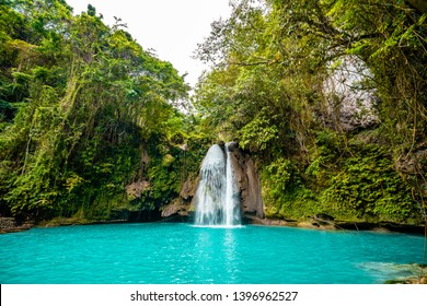 Kawasan Falls on Cebu island in Philippines, turquoise waterfalls