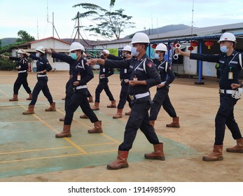 Kawasi, Indonesia: February 11,2021, A number of security guards are doing dril exercise, handcuffs in compliance with health protocols wearing masks and helmets