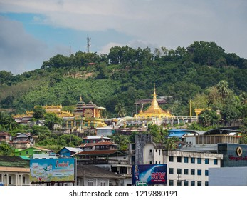 KAWTHOUNG, MYANMAR - OCTOBER  28, 2018 - 10.03: Pyi Daw Aye Pagoda - The golden pagoda at top of the town.