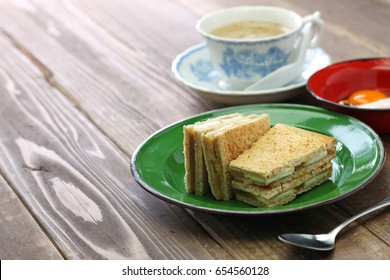 kaya jam toast sandwich with a cup of white coffee, singaporean malaysian breakfast