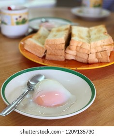 Kaya toast bread with half boiled egg, typical breakfast in Malaysia coffee shop.