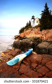 kayak in acadia national park in Maine next to a lighthouse