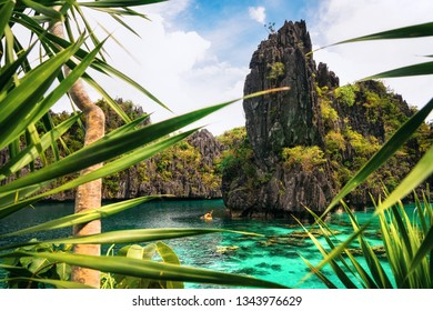 Kayak in the big lagoon with turquoise clean water among rocks and tropical forest, El Nido, Palawan, Philippines