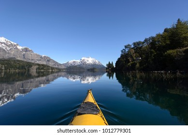 Kayak crossing the lakes of the Argentine Patagonia.