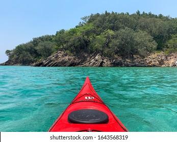 A kayak heading to an island off Guanaja, Honduras