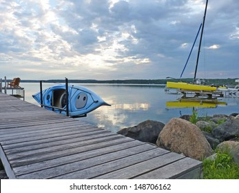 Kayak on Dock with Sailbaot
