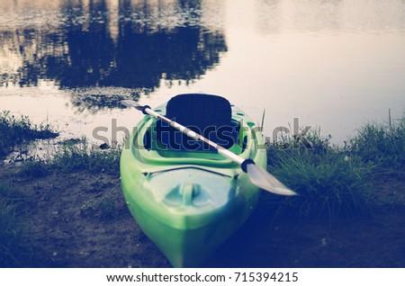 Kayak Paddle Sitting Launch Pond Background Stock Photo