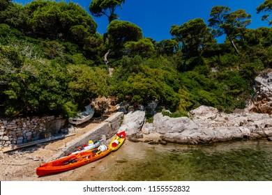 Kayak and path leading to woods on the island of Lokrum, near Dubrovnik, Croatia