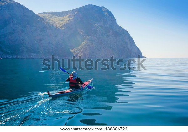 Kayak. People kayaking in the sea. Leisure activities on the calm blue water.