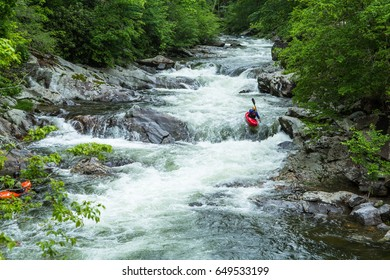 A kayak rider enjoys his adventure sport at The Sinks in Smoky Mountains National Park Tennessee