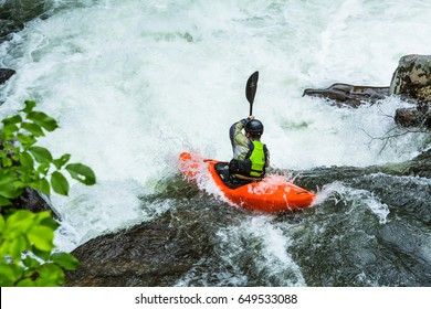 A kayak rider makes the drop into the whitewater of The Sinks in Smoky Mountains National Park in Tennessee