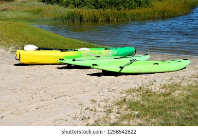 Kayak and surf board at the water's edge