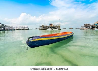 Kayak that is floating on the water at the beach Trikora Bintan Island