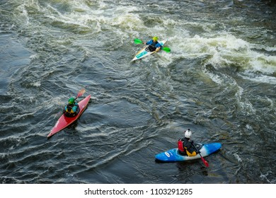 Kayak training/kayakers training within the city under the royal palace bridge where water strong whirlpools arise near the piles. Stockholm, Sweden, May 22, 2018.