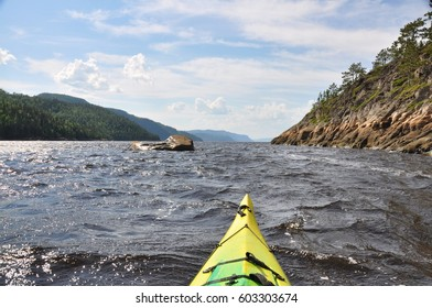 Kayak-camping near a narrowing in the Saguenay fjord (Quebec, Canada)