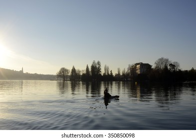 Kayaker and Annecy lake landscapeat sunset in France