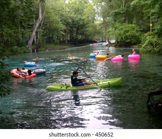 A kayaker maneuvers his way out of the spring at Ginnie Springs in High Springs, Florida.