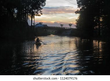 Kayaker on the lake at sunset