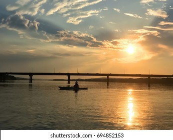 Kayaker on the Saint John River at sunset near downtown Fredericton with Westmorland Bridge in the background,, New Brunswick, Maritimes, Atlantic Canada