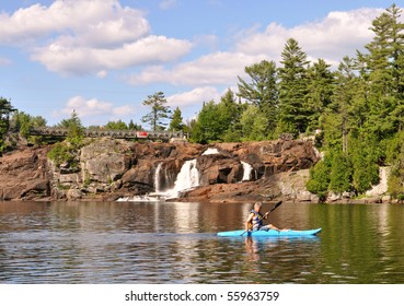 Kayaker under waterfalls