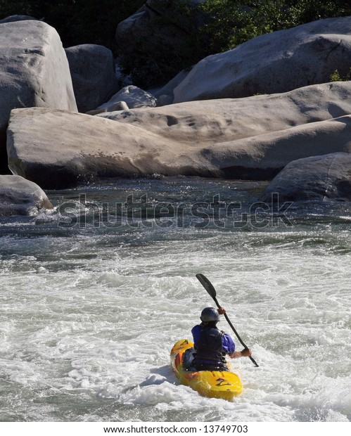 Kayakers brave the exciting class III,IV,and V rapids on the Feather River. The Feather River Canyon, located along Highway 70 between Oroville and Quincy in northern California.