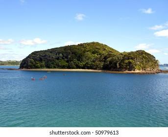 Kayakers circling island from Paihia, Bay of Islands, New Zealand