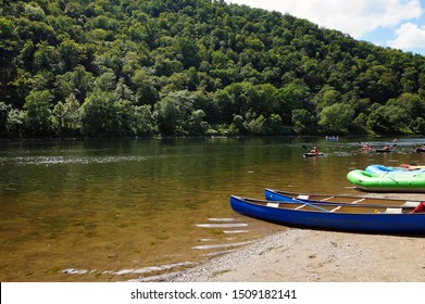 Kayakers in the Delaware River and Canoes and Rafts on the Shore at the Delaware Water Gap in Pennsylvania
